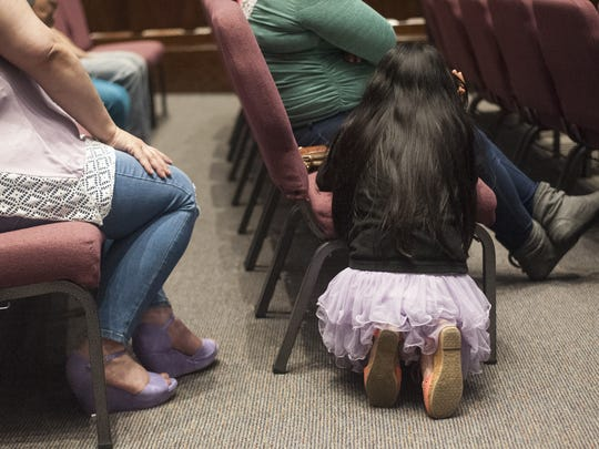Undocumented  immigrants gathered during an information meeting in North Camden.