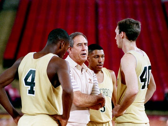 Vanderbilt coach C.M. Newton, second from left, discusses strategy with players Barry Booker, left, Derrick Wilcox and Charles Mayes during practice in Pontiac, Mich., on March 24, 1988, for their Midwest Regional semifinals matchup with Kansas in the NCAA tournament.