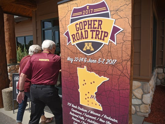 People enter The Grands at Mulligans before the start of the Gopher Road Trip event Wednesday, June 7, in Sartell.