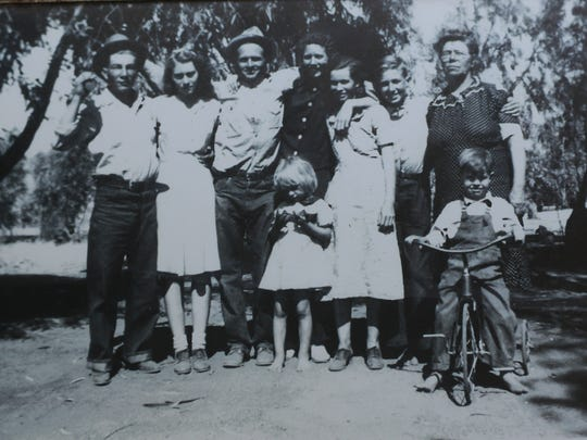 Earnest R. Cowen from Tulare, pictured here in the center of this family photo, was killed during the Battle of the Bulge in World War II.