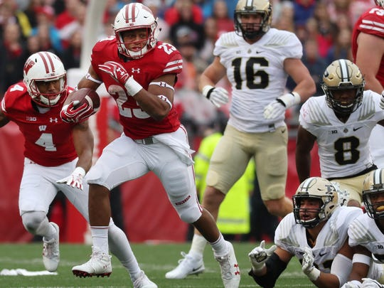 Wisconsin Badgers running back Jonathan Taylor (23) picks up a first down during the Wisconsin vs. Purdue Big Ten football game in Camp Randall Stadium in Madison, Wisconsin, Saturday, October 14, 2016  Milwaukee Journal Sentinel photo by Rick Wood/RWOOD@JOURNALSENTINEL.COM  ORG XMIT: 20093850A