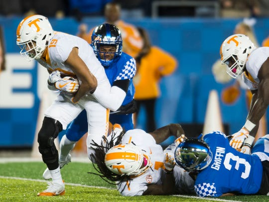 Tennessee wide receiver Jeff George (19) catches a Hail Mary throw but is unable to get through Kentucky's defense to the end zone during the Tennessee vs. Kentucky game at Kroger Field in Lexington, Kentucky Saturday, Oct. 28, 2017. Kentucky defeated Tennessee 29-26.