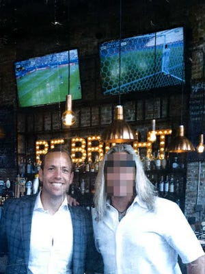 """A photograph of Tallahassee lobbyist Adam Corey with """"Mike Sweets,"""" an undercover FBI agent, at The Edison restaurant. The Democrat decided to blur Sweets' face after discussions with the FBI. Sweets was among several undercover agents sent to Tallahassee to uncover public corruption."""