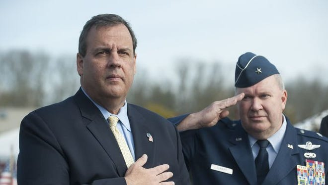 Gov. Chris Christie and Brig. Gen. Michael Cunniff salute during the Flag Retirement Service during the Veteran's Day Ceremony at Brig. Gen. William C. Doyle Veterans Memorial Cemetery.