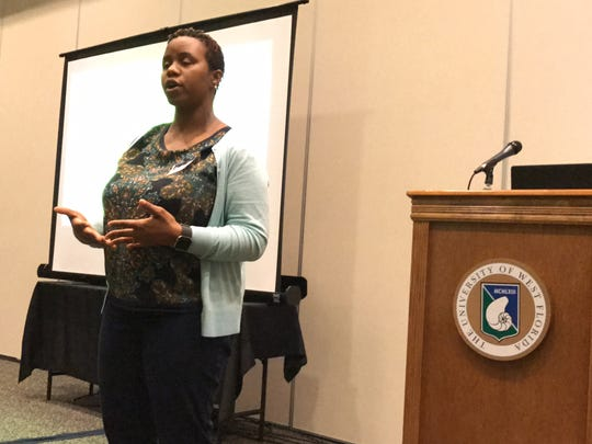 Dione King, a University of West Florida associate professor, speaks at the UWF Women's Studies Conference on Friday, March 24, 2017. King was awarded the Mary Rogers Award at this year's conference.