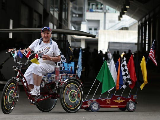 Bobbie Higgins rides a decked out Indianapolis Motor