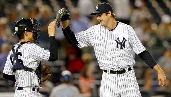 John Ryan Murphy and Andrew Miller of the Yankees celebrate the win over the Kansas City Royals on May 26, 2015 at Yankee Stadium in the Bronx borough of New York City.The Yankees defeated the Kansas City Royals 5-1.