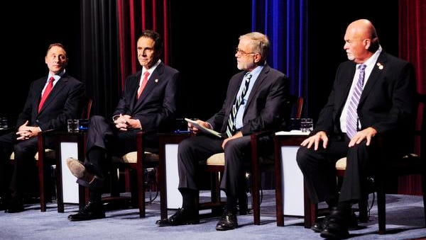 New York gubernatorial candidates, from left, Republican Rob Astorino,  Democratic incumbent Andrew Cuomo,  Green Party candidate Howie Hawkins and Libertarian candidate Michael McDermott take the stage for a debate Wednesday, Oct. 22, 2014, in Buffalo.