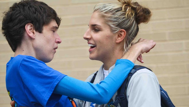Elena Delle Donne gives her sister, Lizzie, a kiss and hug as the University of Delaware women's basketball team returns to the Bob Carpenter Center to cheering fans after their season ended in 2012 in the NCAA tournament.