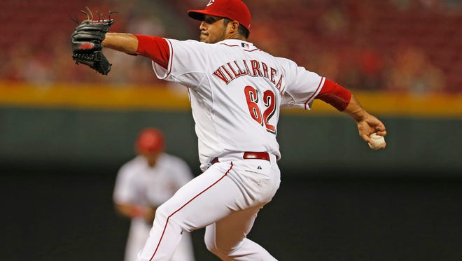 Reds relief pitcher Pedro Villarreal throws against the Braves on Aug. 21.