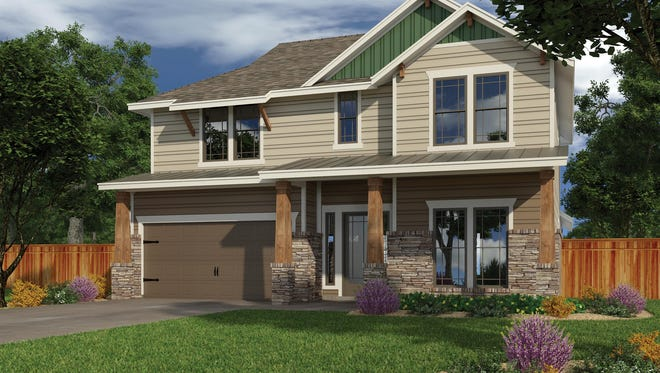 Stone, siding and tapered columns add lots of curb appeal.