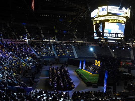 """A crowd sits in Crisler Center during University of Michigan's """"Signing of the Stars"""" event on national signing day at Crisler Center in Ann Arbor, Mich., Wednesday, Feb. 1, 2017. (Melanie Maxwell/The Ann Arbor News via AP)"""