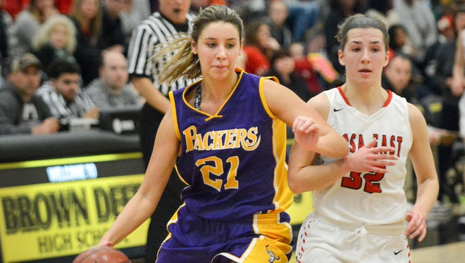 Cudahy's Bailey Eichner elbows her way past Wauwatosa East's Sydney Halstead toward the basket in a WIAA girls basketball sectional final Saturday.