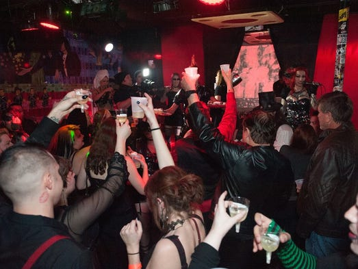 As the ball drops glasses are raised in salute of 2016