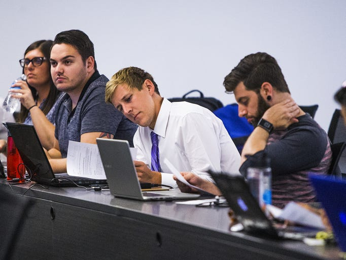 Students listen to a lecture in secured transactions