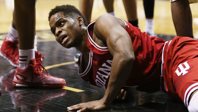 Hoosiers guard Yogi Ferrell can't believe he didn't get a foul call after driving to the basket in the second half and ending up on the floor. Purdue hosted Indiana at Mackey Arena, January 28, 2015.