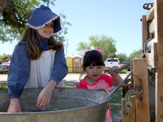Ashlyn Scott and Olivia Cardenas wash clothes the old-fashioned way during the 2016 Frontier Day at Fort Concho.