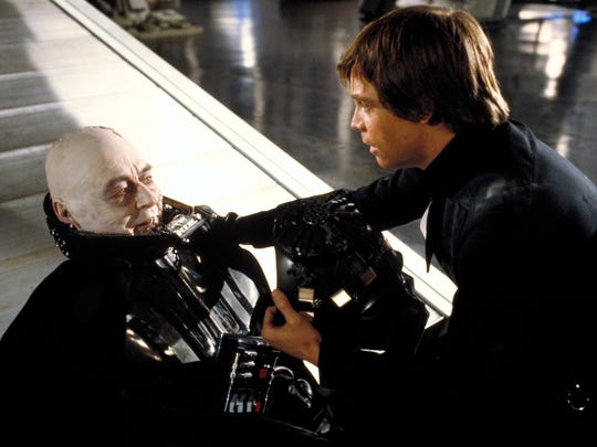 """Darth Vader (Sebastian Shaw, left) finds redemption in his final moments with his son Luke (Mark Hamill) in """"Return of the Jedi."""""""
