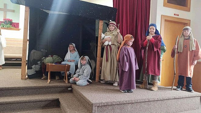 "Zion Hill Baptist Church in Zirconia has traditionally celebrated Christmas with a pageant featuring Sunday School children wearing costumes in a manger scene. The church also provided fruit and candy ""pokes"" for all who attended the annual event."