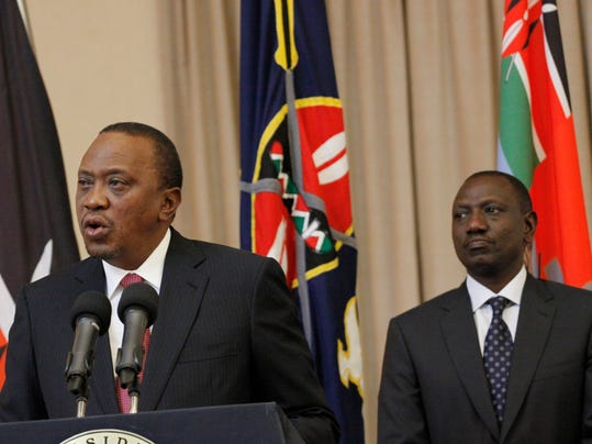 Kenya's President Uhuru Kenyatta, left, accompanied by Deputy President William Ruto, right, speaks to the media at State House in Nairobi, Kenya Thursday, Sept. 21, 2017. Kenya's electoral commission has announced it has moved the date for a fresh presidential election to Oct 26. The electoral commission had earlier set Oct 17 as the date for the fresh poll after the Supreme Court invalidated President Uhuru Kenyatta's August re-election and ordered a rerun within 60 days. (AP Photo/Khalil Senosi)