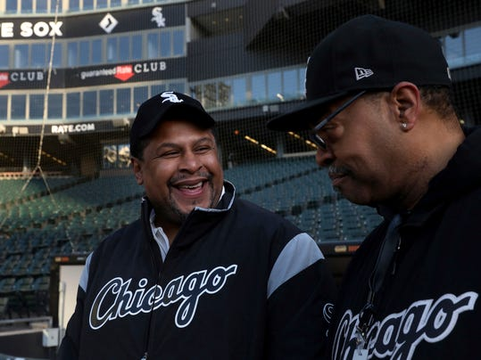 Nevest Coleman, left, smiles as fellow grounds crew and friend Harry Smith Jr. shows off some of the newer features of Guaranteed Rate Field in Chicago, Monday, March 26, 2018. The Chicago Tribune reports that DNA evidence led prosecutors last year to vacate the conviction of 49-year-old Nevest Coleman. He'd been convicted in a 1994 rape and murder. He was released from prison in November and declared innocent last month. (Nancy Stone/Chicago Tribune via AP)
