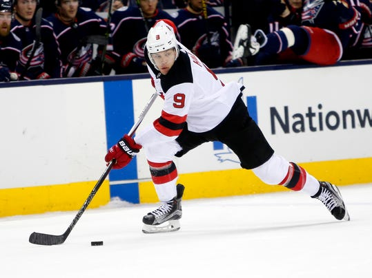 FILE - In this Feb. 10, 2018, file photo, New Jersey Devils' Taylor Hall plays against the Columbus Blue Jackets during an NHL hockey game in Columbus, Ohio. Hall is one of about a dozen players in the NHL MVP race.(AP Photo/Jay LaPrete, File)