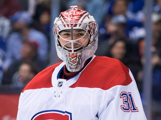 Montreal Canadiens goaltender Carey Price smiles after making a save against the Toronto Maple Leafs during the second period of an NHL hockey game Saturday, April 7, 2018, in Toronto. (Chris Young/The Canadian Press via AP)
