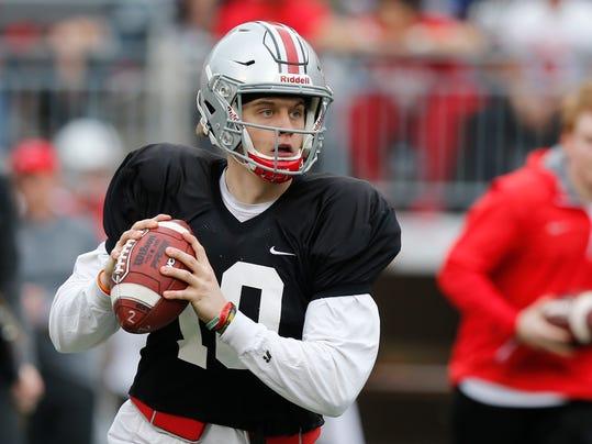 Ohio State quarterback Joe Burrow drops back to pass during their NCAA college spring football game Saturday, April 14, 2018, in Columbus, Ohio. (AP Photo/Jay LaPrete)