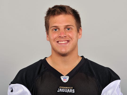"FILE - This 2013 file photo shows Carson Tinker of the Jacksonville Jaguars NFL football team. Tinker is no longer that no-name guy who delivers the ball on punts and kicks. The Jaguars longsnapper shed that anonymity nearly three years ago when an EF-4 tornado ripped through Tuscaloosa, Ala., leaving him physically and emotionally scarred and killing his girlfriend Ashley Harrison. As an Alabama football player, Tinker became one of the faces of a vicious storm that left dozens dead in Tuscaloosa alone. He has since shared his experience with youth groups and churches and written a book _ ""A Season To Remember: Faith in the Midst of the Storm.""(AP Photo/File)"