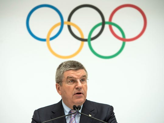 International Olympic Committee, IOC, President Thomas Bach of Germany, speaks during the announcement of the 2022 Olympic Winter Games Candidate Cities (Beijing 2022, Oslo 2022, Almaty 2022) after an executive board meeting, at the IOC headquarters in Lausanne, Switzerland, on Monday, July 7, 2014. (AP Photo/Keystone,Jean-Christophe Bott)