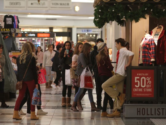 The small line waiting outside Hollister Co. enters the store after they open later in the morning.