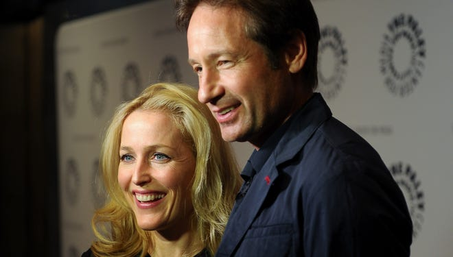 Gillian Anderson and David Duchovny attend The Truth Is Here: David Duchovny And Gillian Anderson On 'The X-Files' at The Paley Center for Media on Oct. 12 in New York City.