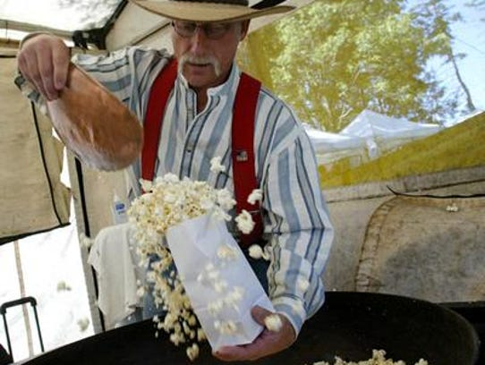 Doug Gutenkunst bags freshly-cooked kettle corn at