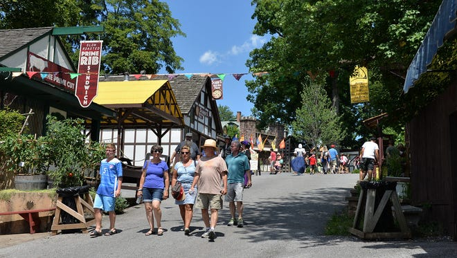 Visitors stroll the the streets of the Shire of Mount Hope during the Pennsylvania Renaissance Faire. Barbara West-Lebanon Daily News