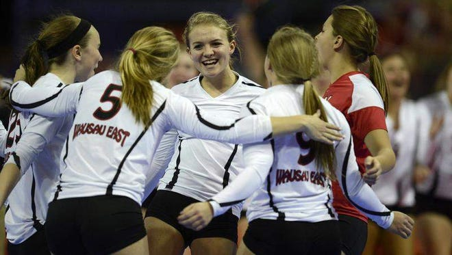 Members of the Wausau East volleybal team celebrate a point during the 2013 WIAA state girls volleyball tournament. Ken Zoromski, who guided the Lumberjacks to the Division 1 quarterfinals that year, died last weekend.