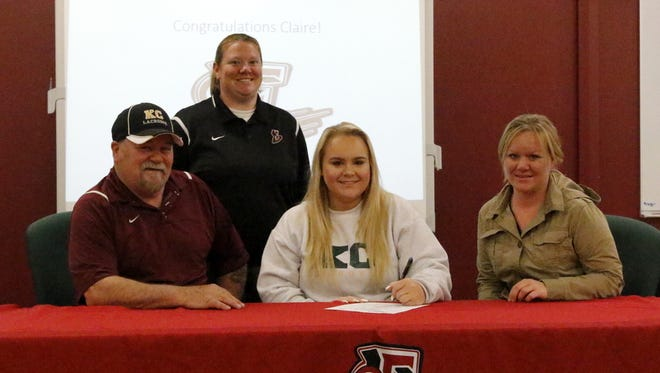 Claire Weideman signs to play lacrosse at Keuka College during a ceremony Tuesday at Elmira High School. Next to her are her mom, Carrie Weideman, and her grandfather, Richard Weideman. In the back is Elmira coach Tammy Woodard.