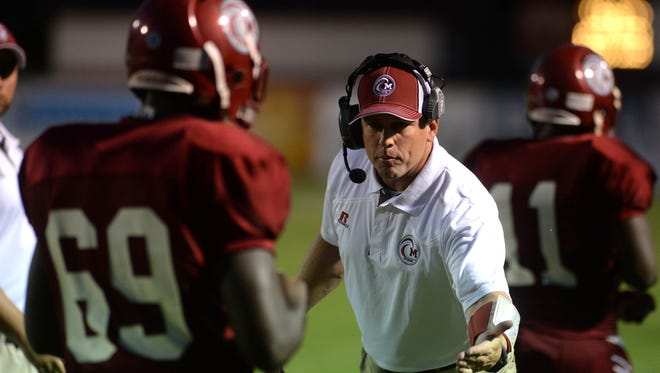 Minden coach Spencer Heard on the sidelines during action Friday night Sept. 26, 2014 against Woodlawn High School.