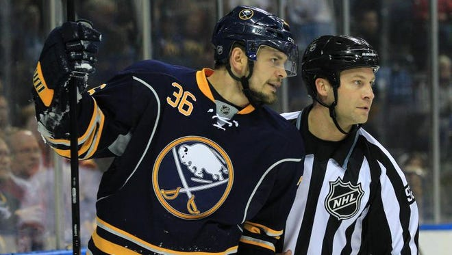 A file photo of Buffalo Sabres right winger Patrick Kaleta talking to linesman Mark Shewchyk during an April game against the Montreal Canadiens.