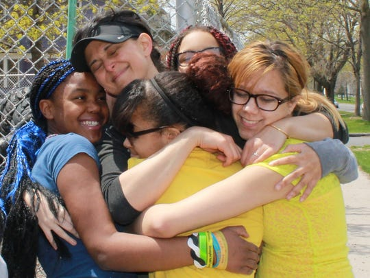 A group hug is shared after some hard work around the grounds at YWCP.