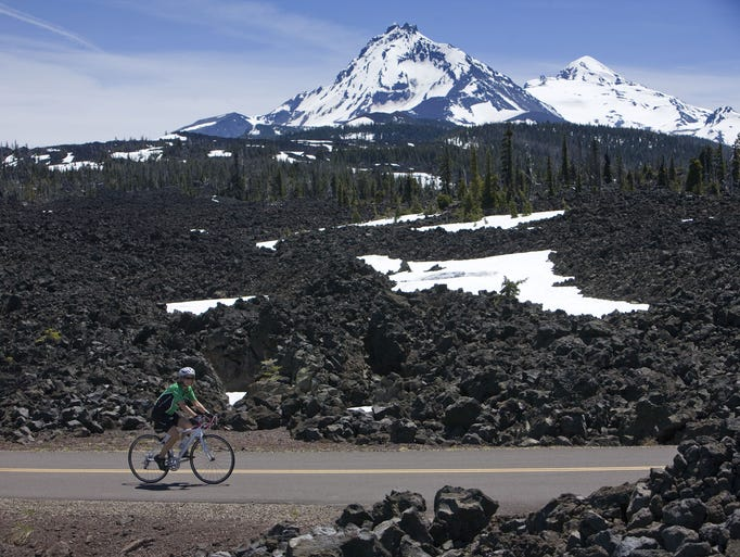 The ride over Mckenzie Pass on Highway 242 is car-free during May and early June. The scenery includes lava fields and views of the Three Sisters. Depending on the time of year, there may be more snow then seen here.