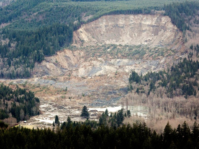 A massive mudslide between the towns of Darrington, Wash., and Arlington, Wash. killed at least four people.