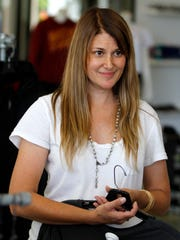 Missy Samiee, co-owns Exit Real World, talks with a customer at the store on Wednesday, Aug. 20, 2014, in Salem, Ore.