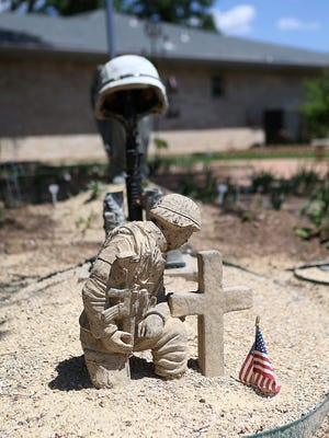 Statues of military service members and public servants are displayed on the front yard of San Angelo resident James Michael Hughes Friday, May 25, 2018. Hughes veteran memorial garden was created to honor all who serve their country.