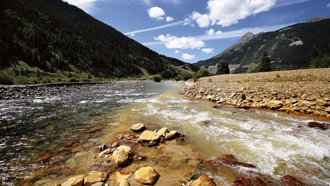 The confluence of Cement Creek, at right, and the Animas River, left, as seen on Monday in Silverton, Colo. This is where the plume of contaminated water from the Gold King Mine entered the Animas River.