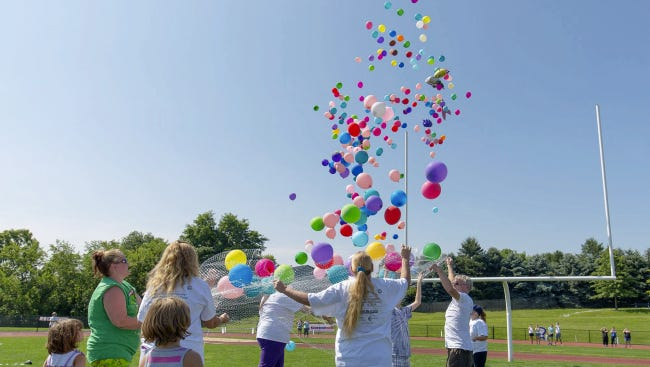Participants release balloons at a past Relay for Life event in Hanover. The 2017 event will be held at the New Oxford High School stadium.