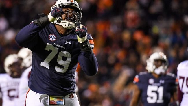 Auburn defensive lineman Andrew Williams (79) celebrates a tackle during the second quarter against the Alabama A&M Bulldogs at Jordan Hare Stadium on Nov 19, 2016.