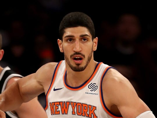 NEW YORK, NY - OCTOBER 27:  Enes Kanter #00 of the New York Knicks celebrates his basket in the second half as Joe Harris #12 of the Brooklyn Nets looks on at Madison Square Garden on October 27, 2017 in New York City. NOTE TO USER: User expressly acknowledges and agrees that, by downloading and or using this Photograph, user is consenting to the terms and conditions of the Getty Images License Agreement  (Photo by Elsa/Getty Images) ORG XMIT: 775026721 ORIG FILE ID: 867250080