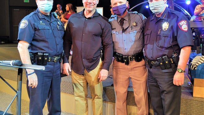 Praise Assembly Lead Pastor Steve Chavez, second from left, with local law enforcement leaders, left to right, Kirk Taylor, Brian Lyons and Troy Davenport.
