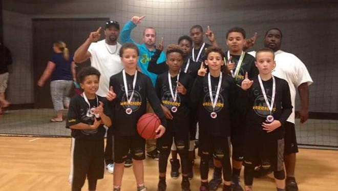 The Western North Carolina Warriors fifth-grade boys basketball team won its age group at this past weekend's Mountain Mayhem tournament.
