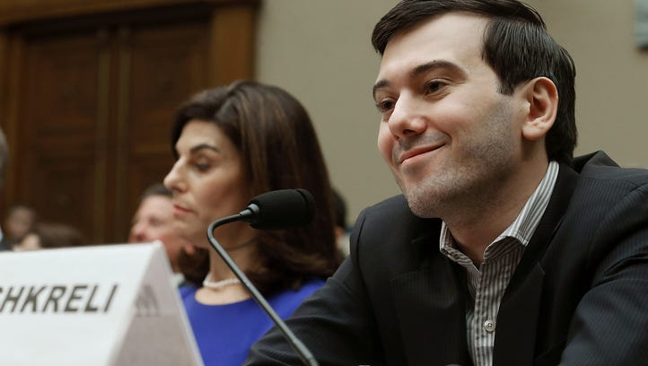 Martin Shkreli, former CEO of Turing Pharmaceuticals LLC., smiles while flanked by Nancy Retzlaff, chief commercial officer for Turing Pharmaceuticals LLC., during a House Oversight and Government Reform Committee hearing on Capitol Hill, on February 4, 2016 in Washington, D.C.